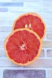 Fresh grapefruit. Fresh close up slice of ripe grapefruit Stock Image