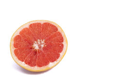 Fresh grapefruit cut in half isolated over the white background, top view. Grapefruit cut in half isolated over the white background, top view stock image