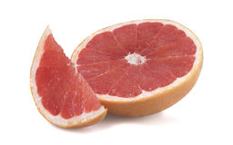 Fresh grapefruit. Cut in half on white table stock images