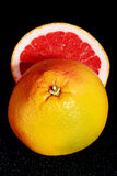 Fresh grapefruit divided into two pieces. Stock Photos