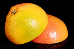 Fresh grapefruit divided into two pieces. Royalty Free Stock Photography
