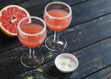 Fresh grapefruit juice in glass beakers Stock Images