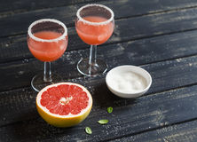 Fresh grapefruit juice in glass beakers Stock Photos