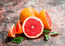 Fresh grapefruit with leaves stock images