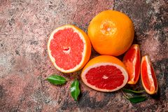 Fresh grapefruit with leaves royalty free stock photography