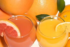Fresh grapefruit and orange juice stock images