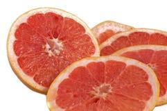 Fresh grapefruit rings set isolated on white background. Fresh red grapefruit rings set isolated on white background stock photo