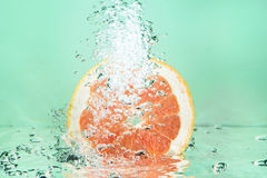 Fresh grapefruit splash Stock Photography