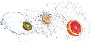 Fresh grapefruit with water splash, isolated on white background. Studio shot of fresh grapefruit with water splash, isolated on white background stock images