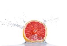 Fresh grapefruit in water splash on white Royalty Free Stock Images