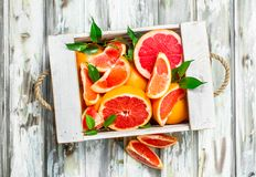Fresh grapefruit in wooden box stock images