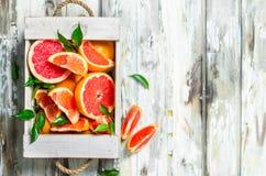 Fresh grapefruit in wooden box stock image