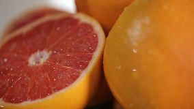Fresh grapefruits on the plate, prepared birthday table with fruits closeup stock video footage