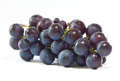 Fresh grapes. Fresh washed wet grapes on a white background Stock Photography