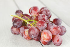 Fresh grapes. Fresh blue grapes on a wooden table Royalty Free Stock Image