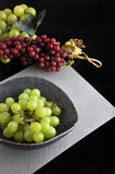 Fresh Grapes in Bowl on Black Background Royalty Free Stock Images