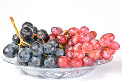 Fresh grapes in clear plate. On white background Stock Images