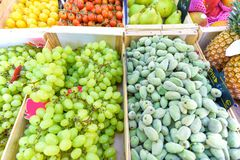 Fresh grapes, figs, lemons, tomatoes, pears and pineapples for s. Ale in local marketplace Royalty Free Stock Images