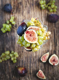 Fresh grapes and figs in vase Royalty Free Stock Photos