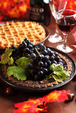 Fresh grapes and glass of wine. With apple pie for Thanksgiving Stock Images