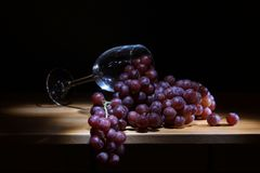 Grapes and glass royalty free stock image