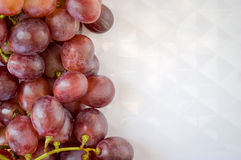 Fresh grapes. Grape cluster on white dish Royalty Free Stock Images
