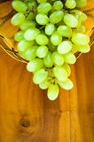 Fresh grapes. Grape cluster on wooden background Royalty Free Stock Photo