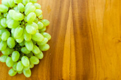 Fresh grapes. Grape cluster on wooden background Stock Photo