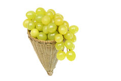 Fresh grapes kept in handwoven conical basket Stock Photos