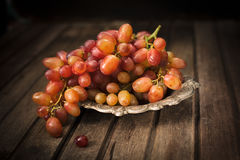 Fresh grapes in metal palate on wooded background, horizontal co. Mposition stock images