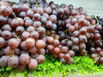 Fresh grapes are placed at the supermarket counter for sale Royalty Free Stock Image