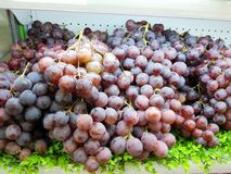 Fresh grapes are placed at the supermarket counter for sale Stock Photography