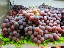 Fresh grapes are placed at the supermarket counter for sale Royalty Free Stock Photo