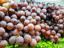 Fresh grapes are placed at the supermarket counter for sale Stock Photo