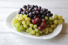 Fresh grapes on plate Royalty Free Stock Image