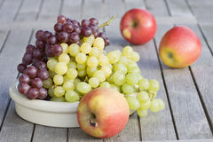 Fresh grapes and red apples Stock Photos