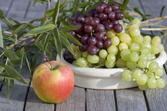 Fresh grapes and red apples outdoor Stock Image