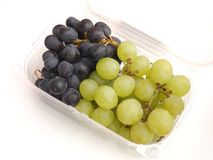 Fresh grapes. Some fresh grapes in green and blue stock photo