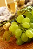 Fresh grapes, vine and vine bottle, holiday Stock Images