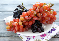 Fresh grapes on a white plate Royalty Free Stock Image