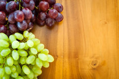 Fresh grapes. White and Red Grapes on the table Royalty Free Stock Photo