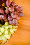 Fresh grapes. White and Red Grapes on the table Royalty Free Stock Photography