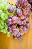 Fresh grapes. White and Red Grapes on the table Royalty Free Stock Photos