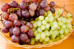 Fresh grapes. White and Red Grapes on the table Stock Photos
