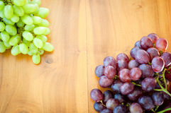 Fresh grapes. White and Red Grapes on the table Stock Images