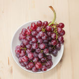 Fresh grapes on wood royalty free stock photography