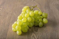 Fresh grapes on wooden background Stock Photography