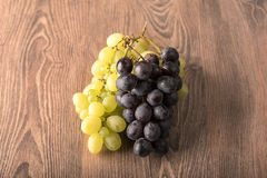 Fresh grapes on wooden background Royalty Free Stock Image