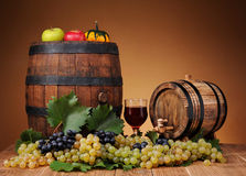 Fresh grapes, wooden barrel and a glass of wine Stock Photo