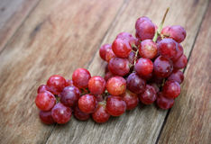 Fresh Grapes on a wooden table Stock Photography